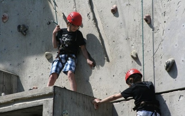 Home Page Features - Two boys on climbing wall